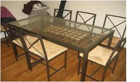 Ikea Granas glass table and 4 chairs in black metal with flax straw seats.
