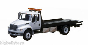 International Durastar 4400 Flatbed White rollback Flatbed pre sale tow truck