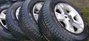 A set of 4 Ford Escape wheel P245/65R17 Goodyear Wrangler tires