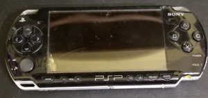 PSP with 8 games, protective case , and charger