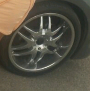 "20"" chrome rims and low profile tires"