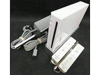 Nintendo wii console Comes with 2 wii remotes/ loads of extras/ 1 top game of ur choice