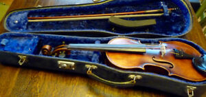 3/4 violin. German 204-779-4090