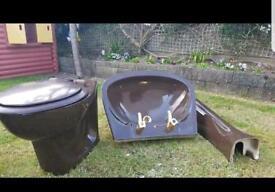 Brown cast iron bath, toilet & sink