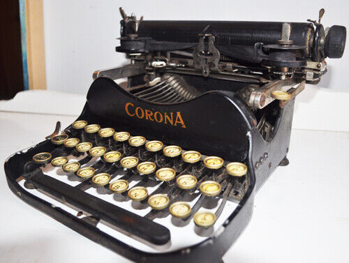 Two antique Corona Portable Typewriters w/cases.