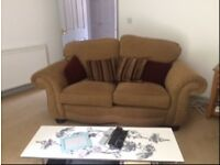Nearly new light brown two seater sofa