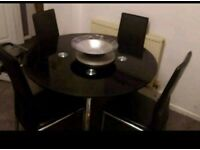black glass dining table 4 chairs ( can deliver)
