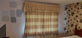 Curtains for two windows with tasselled tie-backs