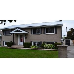 Raised Bungalow 4 Bedrooms + family room. Great Location