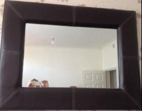 Brown padded leather mirror