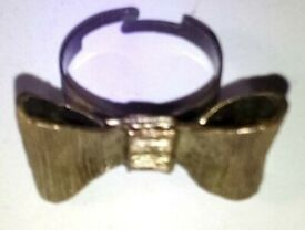 Ladies Next Gold Toned Bow Fashion Ring.Size Adjustable.P&P INCLUDED!