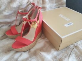 Michael Kors wedges, never worn, size 4, colour red.