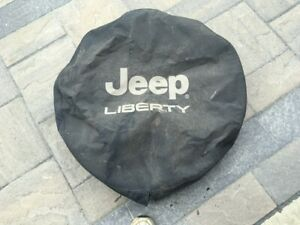 JEEP LIBERTY OEM SPARE TIRE COVER - DAMAGE FREE, NEEDS CLEANING