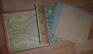 Lots and lots of NEW scrapbooking paper, ribbons, paper tape