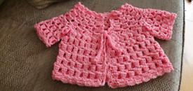 Crocheted tea party cardigan