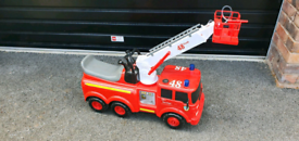 Ride on fire engine with moving ladder