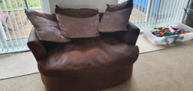 BROWN TWO SEATER SWIVEL CHAIR