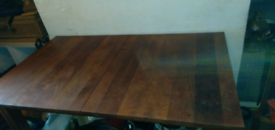 Solid walnut or chestnut table with 4 black leather padded chairs