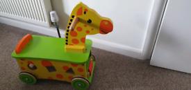 Ride on wooden giraffe