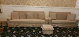Two settee beds one large and small one with two footstools