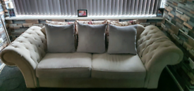 Chesterfield style fabric sofa.