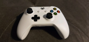 Xbox One white wireless controller.