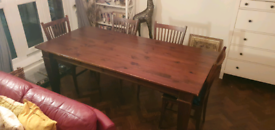Dark solid wood dining table and four chairs