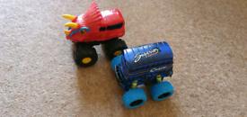 Toy Monster trucks. Dinosaur and double decker bus