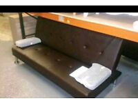 A brand new brown leather effect click clack sofa bed.