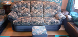 2 lots of 3 seater blue velvet sofas with 2 matching foot stools