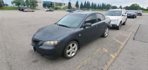 2005 Mazda 3. Reliable daily driver.
