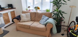 Lovely cream two seater sofa