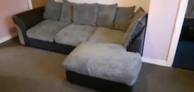 Black and grey corner sofa and large cuddle chair