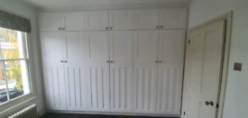 Mdf fitted wardrobes . Egshell paint sprayed.