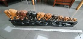 Elephants crossing bridge wooden sculpture