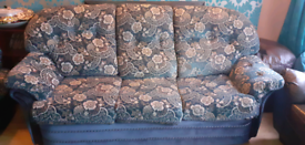 2 Blue 3 seater velvet sofas with 2 matching foot stools
