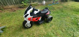 Kids BMW RR electric motorbike.