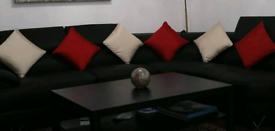 Faux leather black corner sofa