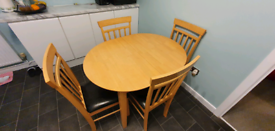 4-6 seater extendable dining table and 4 chairs