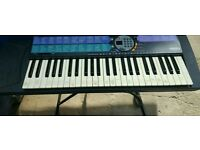 Casio keyboard with stand complete with charger