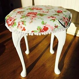 White wooden vintage stool with floral fabric