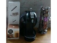 Dolce Gusto coffee machine with 70+ pods and holder