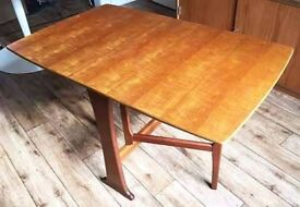 Space saving, mid-century drop leaf teak dining table