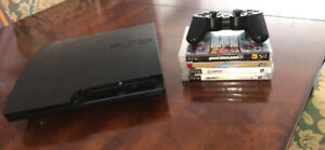 PS3 console with one controller,wires,charger & 4 Games/Jeux