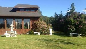 LARGE HOME ON QUIET ACREAGE FIVE MINUTES FROM THE MALL IN THE BX