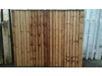 """feather edged tanilized fencing panels. X 18 5FT 6"""" IN HIGHT BY 6FT WIDE HEAVEY DUTY.CHEAP LOOK."""