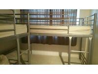 2 metal bunk beds with 4 mattresses