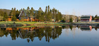 IMMACULATE CUSTOM CHALET ON RIVER FRONT CLARKES BEACH NL