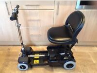 CARECO SCOOTCASE COMPACT / FOLDING ELECTRIC WHEELCHAIR IN GREAT CONDITION.