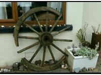 Large antique wooden cart wheel
